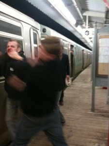 Gay Basher Benjamin Eder openly punches victim Daniel Hauff on a Chicago train platform.