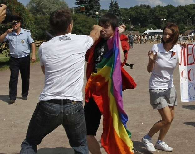 2012 Russian gay pride event ends in violence. Here an anti-gay protestor punches a man. Photo Credit Alexander Demianchuk, Reuters