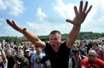 """Anti-Gay protestors,"" i.e. State-Approved Gay Bashers. Credit: Olga Maltseva, Getty Images."
